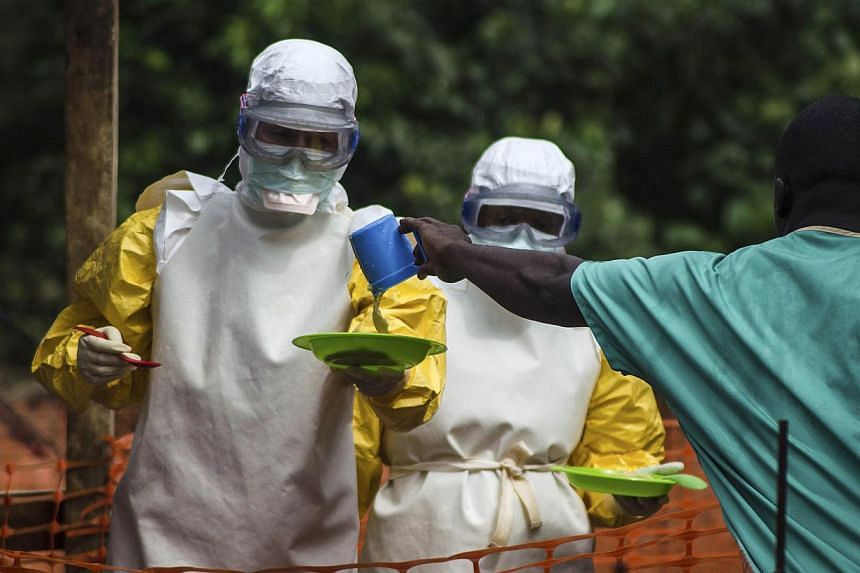 Medical staff working with Medecins sans Frontieres (MSF) prepare to bring food to patients kept in an isolation area at the MSF Ebola treatment centre in Kailahun on July 20, 2014. Fears that the west African Ebola outbreak could spread to Euro