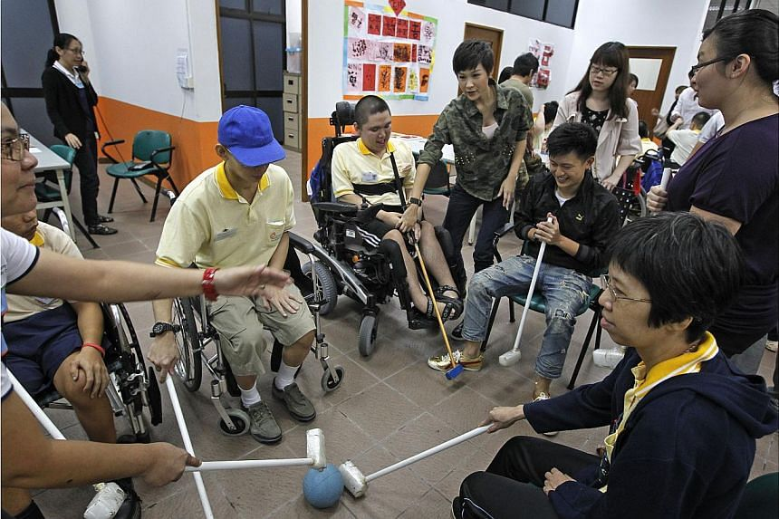 Beneficiaries of the Society for the Physically Disabled playing a modified hockey game in 2013. -- PHOTO: ST FILE