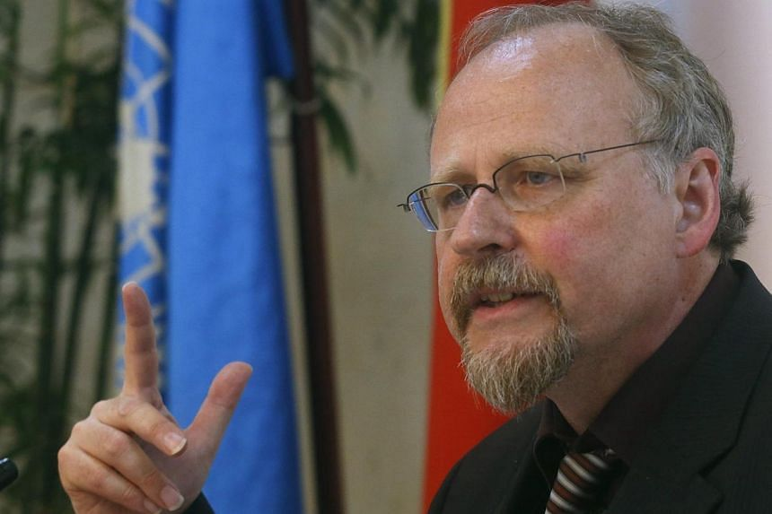 "United Nations Special Rapporteur on freedom of religion or belief Heiner Bielefeldt speaks at a news conference in Hanoi on Thursday, July 31, 2014. A UN expert expressed worry on Thursday over ""serious violations"" of religious freedom in Vietn"
