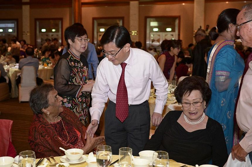 Education minister Heng Swee Keat (centre) greets 100-year-old Mrs Mangalesvary Ambiavagar (left), former principal of Raffles Girls' Primary, Bedok Girls' and Balestier Boys' School, during the Ministry of Education dinner to honour pioneer educator