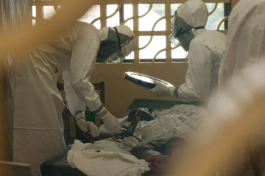 Dr. Kent Brantly (left) of Samaritan's Purse relief organization is shown in this undated handout photo provided by Samaritan's Purse, wearing personal protective equipment as he cares for Ebola patients at the case management center on the campus of