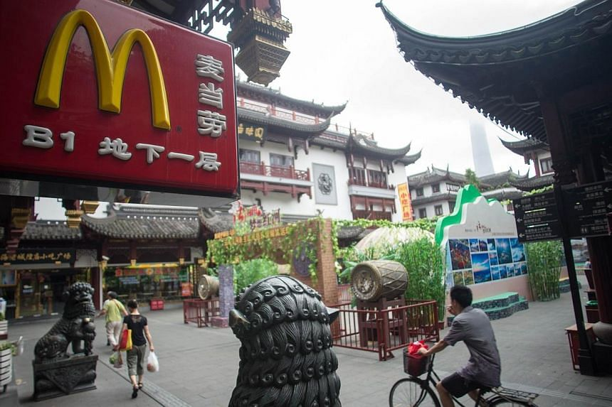 A McDonald's restaurant logo is seen on July 24, 2014 in Shanghai. A food safety scare in China is testing local consumers' loyalty to foreign fast-food brands, including McDonald's Corp and Yum Brands Inc, which owns the KFC and Pizza Hut chain
