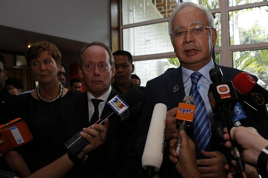 Malaysian Prime Minister Najib Razak (right), with Dutch ambassador Harry Molenaar, speaks to the press about the recovery of bodies killed when Malaysian Airlines MH17 was shot down over the Ukraine, at the residence of the Netherlands' ambassador i