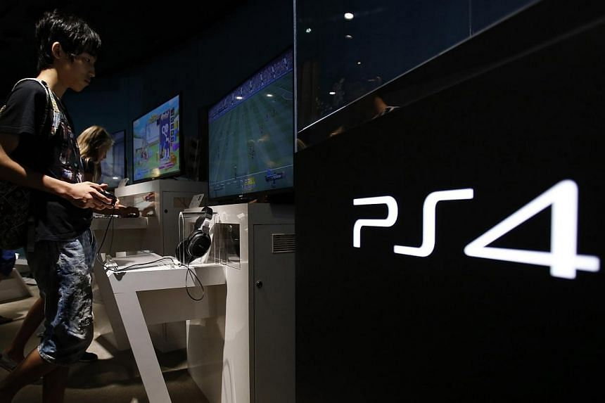Sony said on Thursday that it posted a US$261 million (S$325 million) quarterly net profit thanks to brisk sales of its PlayStation 4 console and a weak yen, but it still expects a full-year loss. -- PHOTO: REUTERS