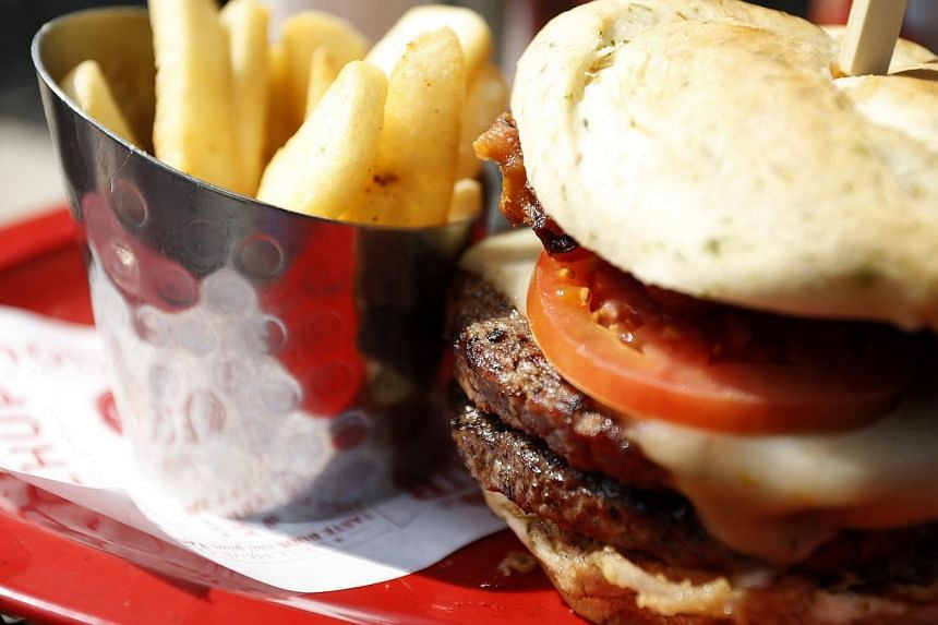 """A meal of a """"monster-sized"""" A1 peppercorn burger and bottomless steak fries is seen at a Red Robin restaurant in Foxboro, Massachusetts on July 30, 2014. -- PHOTO: REUTERS"""