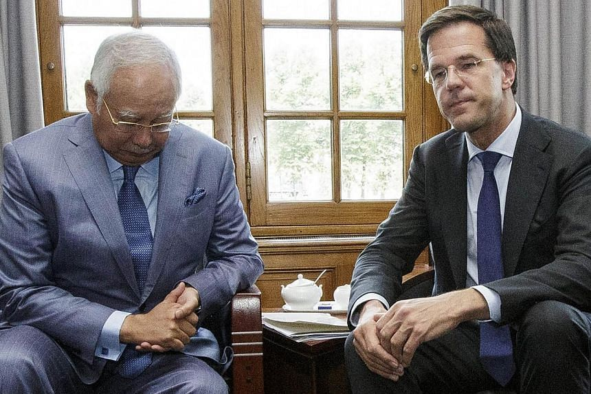 "Malaysian Prime Minister Najib Razak (left) and Dutch Prime Minister Mark Rutte (right) pose prior to their talks in The Hague on July 31, 2014. Mr Najib appealed on Thursday, July 31, 2014, for an ""immediate cessation"" of fighting between Ukraine go"