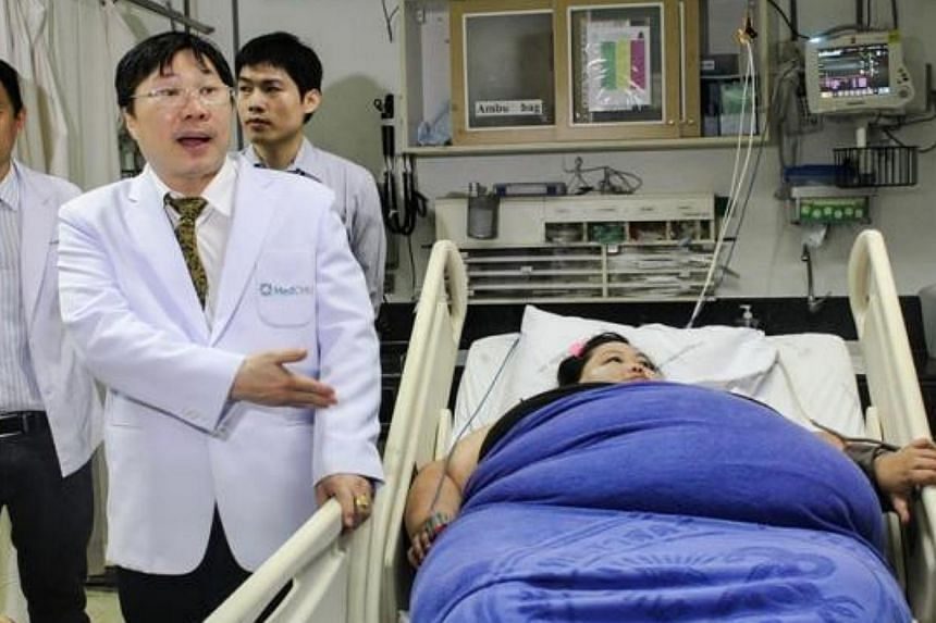 A 300-kg woman who is unable to walk was admitted to the Maharaj Nakhon Chiang Mai Thursday, July 31, 2014, morning. -- PHOTO:THE NATION/ASIA NEWS NETWORK