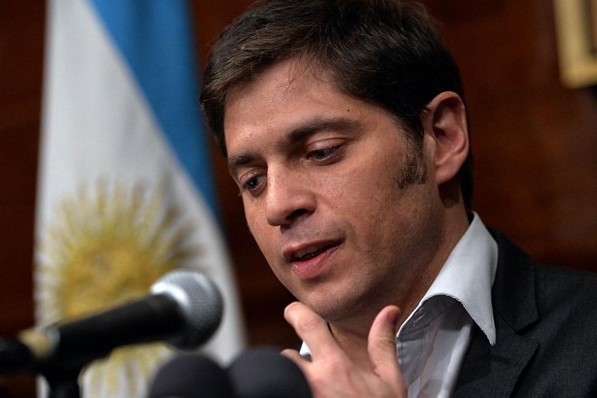 Argentina's Economy Minister Axel Kicillof speaks during a press conference at the Argentina Consulate on July 30, 2014 in New York as talks continue into Argentina's debt.Argentina failed to strike a deal to avert its second default in more th
