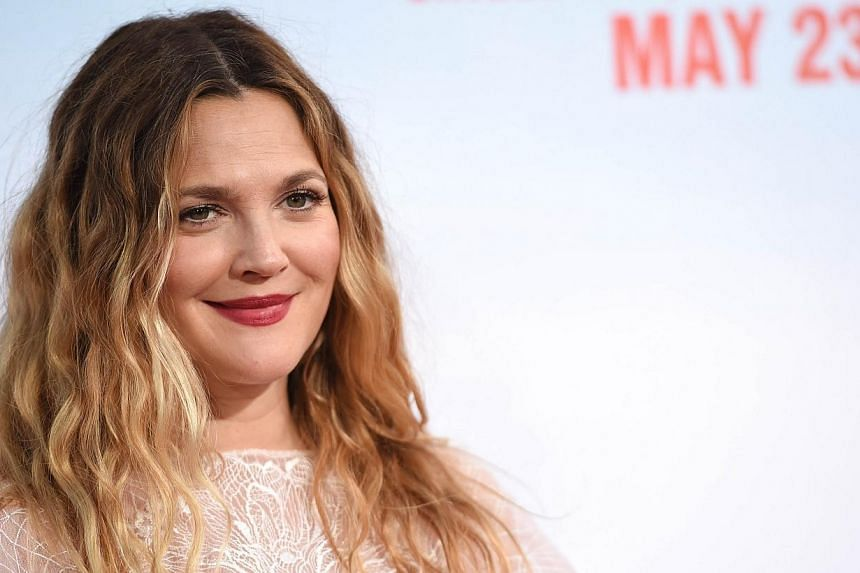 Actress Drew Barrymore's (above) half-sister was found dead in her vehicle parked on a suburban San Diego street, the San Diego County Coroner said on Wednesday. -- PHOTO: AFP