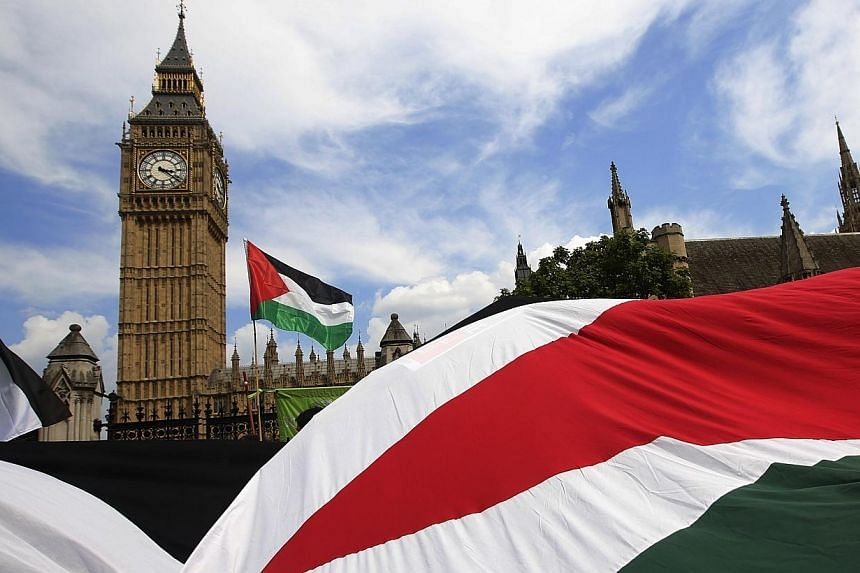 Demonstrators carry Palestinian flags as they protest outside the Houses of Parliament in central London on July 26, 2014.Anti-Semitic incidents in Britain have risen to a near record level since the start of an Israeli assault on the Palestini