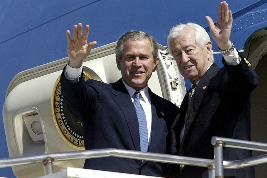 """US President George W. Bush and Congressman Ralph Hall (right) ,R-TX, wave as they arrive on Air Force One at Love Field in Dallas, Texas in this March 8, 2004 file photo.Former US president George W. Bush has written a """"personal biography"""" of"""