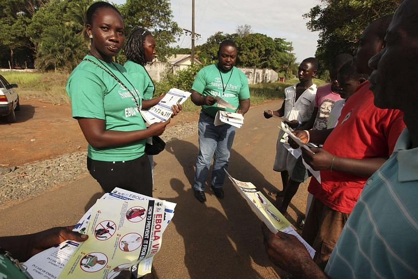 A Samaritan's Purse team member hands out pamphlets to educate the public on the Ebola virus in Monrovia, Liberia in this undated handout photo courtesy of Samaritan's Purse. -- PHOTO: REUTERS