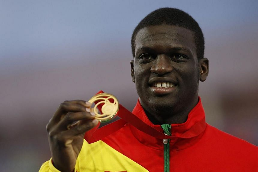 Gold medallist Kirani James poses on the podium during the award ceremony for the men's 400m athletics event at Hampden Park during the 2014 Commonwealth Games in Glasgow, Scotland on July 30, 2014.-- PHOTO: AFP