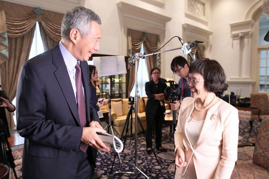 Prime Minister Lee Hsien Loong is seen here with Hu Shuli, one of the winners of this year's Magsaysay Award. The61-year-old founder and editor of Caijing, a business magazine famed for its groundbreaking investigative reporting in China, was i