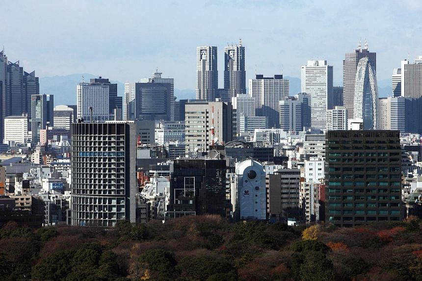 Residential and commercial buildings stand in Tokyo, Japan, on Friday, Dec 18, 2009. Japan's government will lower the corporate tax rate by 2 percentage points from next fiscal year as part of Prime Minister Shinzo Abe's drive to encourage dome