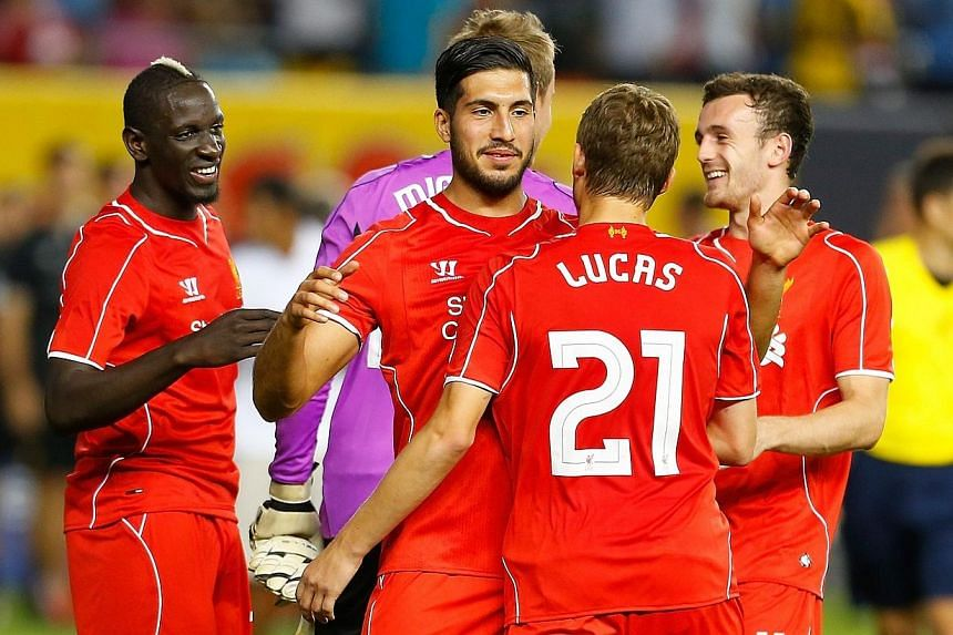 Liverpool celebrates after defeating Manchester City during the International Champions Cup 2014 at Yankee Stadium on July 30, 2014 in the Bronx borough of New York City.Liverpool rallied twice against Manchester City and triumphed 3-2 in a pen
