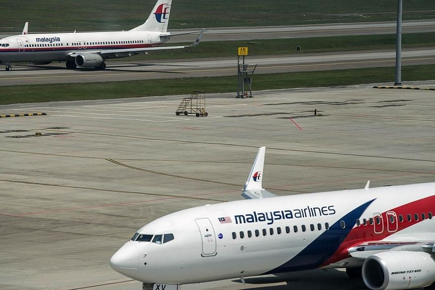 This photo taken on July 21, 2014, shows Malaysia Airlines planes on the tarmac at Kuala Lumpur International Airport in Sepang. Passengers and crew aboard a Malaysia Airlines flight from Adelaide to Kuala Lumpur on Tuesday had a scare when the aircr