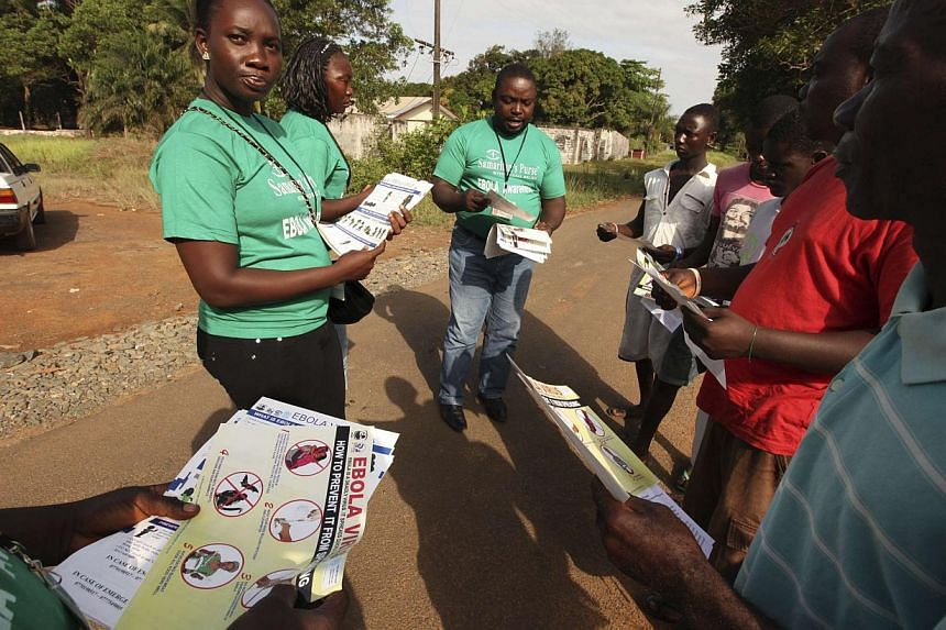 A Samaritan's Purse team member hands out pamphlets to educate the public on the Ebola virus in Monrovia, Liberia.British border staff are not ready to deal with possible Ebola cases arriving in the country and there are no containment faciliti