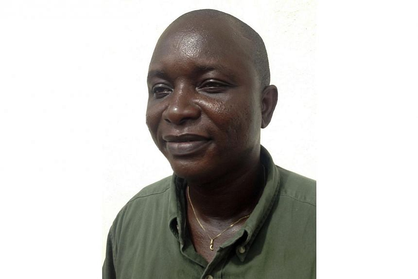 """Sheik Umar Khan, head doctor fighting the deadly tropical virus Ebola in Sierra Leone, poses for a picture in Freetown on June 25, 2014.Sierra Leone on Thursday, July 31, buried a doctor it hailed as a """"national hero"""" for saving the lives of mo"""