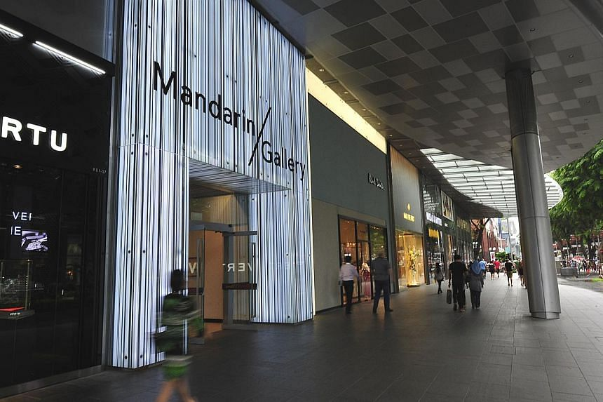 Cutting property expenses helped OUE Hospitality Trust, which owns the Mandarin Gallery along Orchard Road,  post distributions that were higher than forecast for the second quarter of the year. -- ST FILE PHOTO