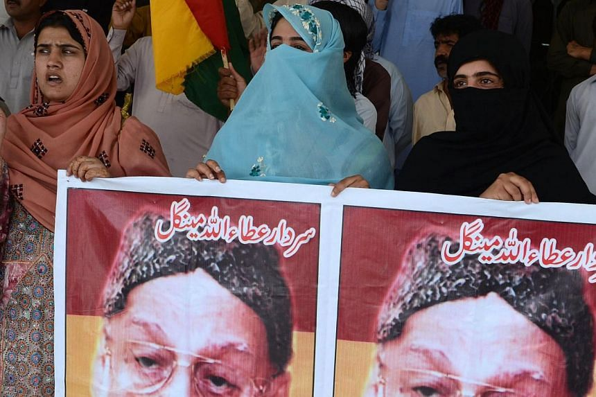 This photograph taken on July 23, 2014, shows Pakistani activists from a regional Baluchistan Nationalist party as they chant slogans during a demonstration outside the Bolan Medical Complex where in Quetta in southwestern Baluchistan province, the f