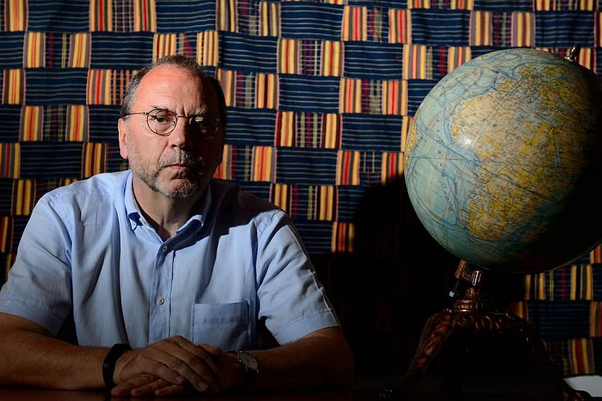 Professor Peter Piot, the Director of the London School of Hygiene and Tropical Medicine, poses for photographs following an interview at his office in central London, England, on July 30, 2014. -- PHOTO: AFP