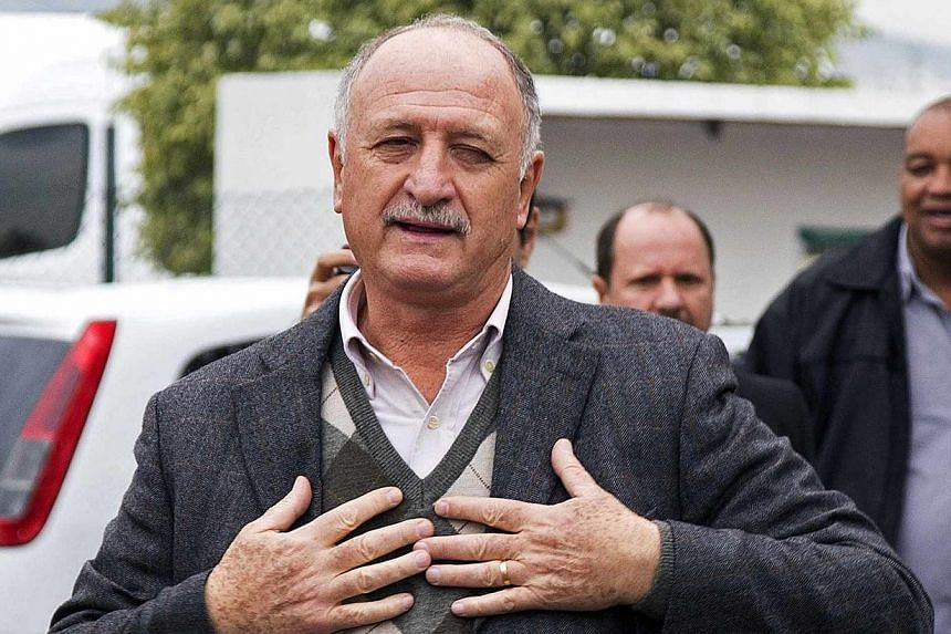 Brazil's former national team coach Luiz Felipe Scolari arrives at the Salgado Filho airport, before being presented to the media as the new coach of Gremio, in Porto Alegre, on July 30, 2014. Scolari said he needed a hug and some affection as t