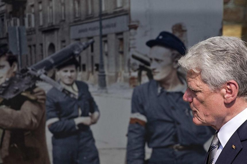 "German President Joachim Gauck visits July 29, 2014, the exhibition ""The Warsaw Uprising 1944"", a Berlin exhibition about the uprising of the Polish resistance against Nazi occupiers during World War II.  -- PHOTO: REUTERS"