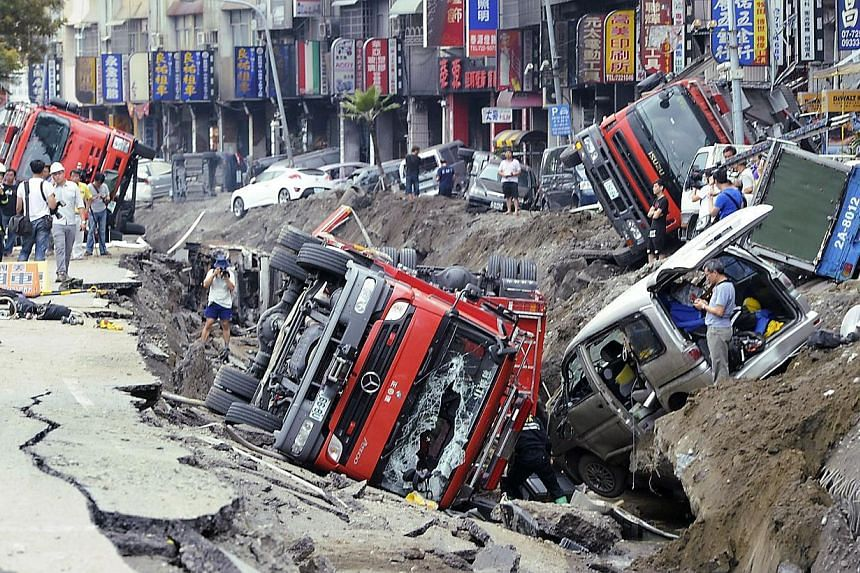 Rescue personnel survey the wreckage after an explosion in Kaohsiung, southern Taiwan, on Aug 1, 2014. The explosion caused by a gas leak in Taiwan's second city killed 24 people, injured 271 and sent flames shooting 15 storeys into the air, a govern