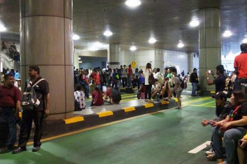 A Twitter user posted this picture of commuters apparently stranded at the Checkpoint. --PHOTO: SHING/TWIITER