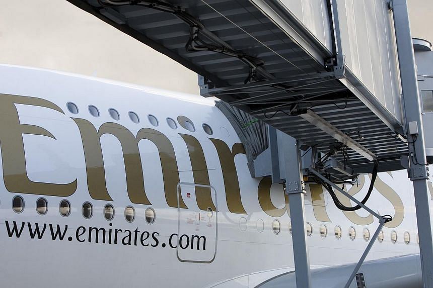 An Emirates Airline Airbus A380 airplane sits on the tarmac at Manchester airport in Manchester, UK on Thursday, Oct 21, 2010. -- PHOTO: BLOOMBERG