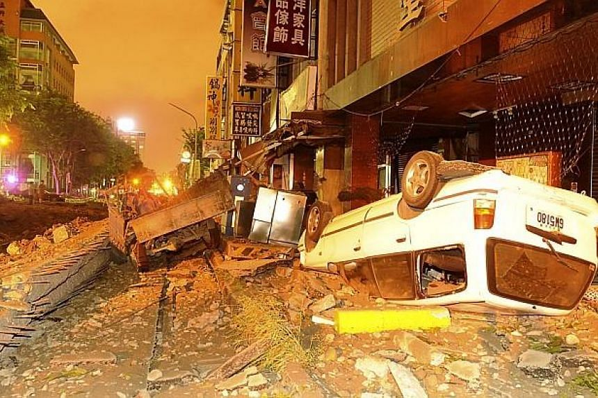 The wreckage of vehicles is seen among debris after an explosion in Kaohsiung, southern Taiwan on Aug 1, 2014. -- PHOTO: REUTERS