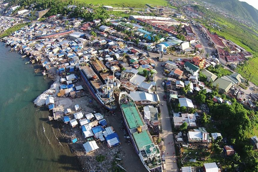 Aerial of the coastal community, with ships brought aground by Typhoon Haiyan, in Anibong subdistrict of Tacloban City, Leyte province, in central Philippines on May 1, 2014. -- ST PHOTO: KEVIN LIM