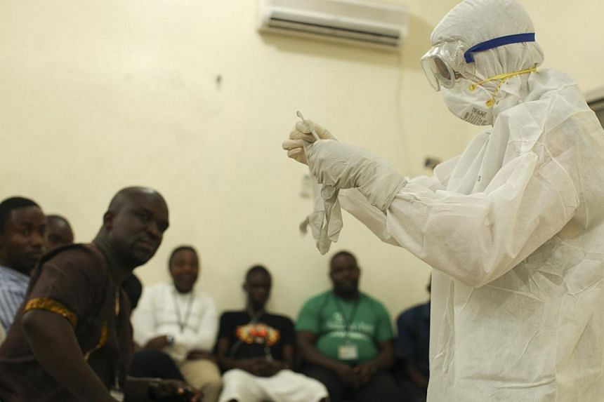 A Samaritan's Purse medical personnel demonstrates personal protective equipment to educate team members on the Ebola virus in Liberia in this undated handout photo courtesy of Samaritan's Purse. -- PHOTO: REUTERS