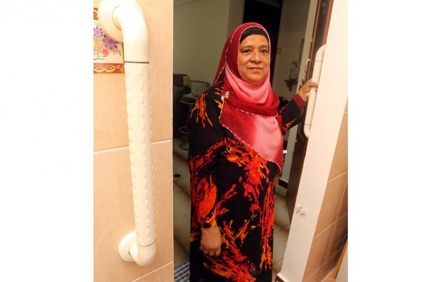 Madam Hajara Mohamed standing at the entrance of a bathroom in her three-room HDB flat in Bedok North on 22 Nov 2012. Equipped with elderly friendly features, Madam Hajara's flat was chosen under the Home Improvement Programme (HIP) and Enhancement f
