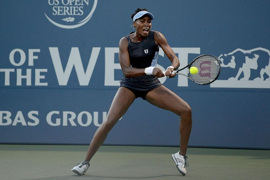Venus Williams of the Unites States of America plays against Victoria Azarenka of Belarus during Day 4 of the Bank of the West Classic at the Taube Family Tennis Stadiumon on July 31, 2014, in Stanford, California. -- PHOTO: AFP