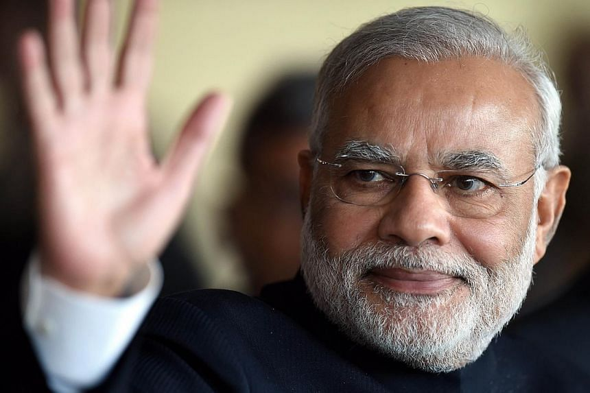 """Sri Lanka extended an """"unqualified apology"""" to Indian Prime Minister Narendra Modi on Friday over an article and uncomplimentary illustration of the leader and a regional Tamil politician published on a government website. -- PHOTO: AFP"""