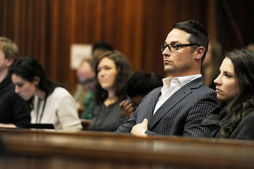 Carl Pistorius (second, right) and Aimee Pistorius (right), the siblings of South African paralympian Oscar Pistorius, sit at the High Court in Pretoria during Oscar Pistorius' trial on July 2, 2014. -- PHOTO: AFP