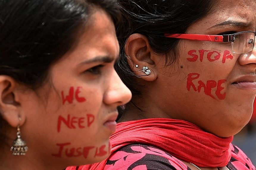 Indian activists participate in a rally organised by The Red Brigade - Bring Bangalore Back campaign to protest against the recent incidents of sexual abuse, molestation and rapes against women in Bangaloreon July 20, 2014. -- PHOTO: AFP