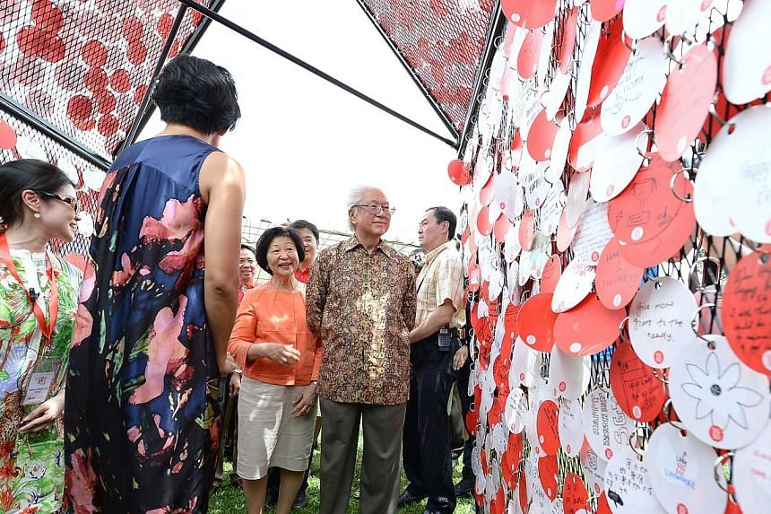 President Tony Tan and his wife at this year's Istana open house event on Saturday, Aug 2, 2014. -- ST PHOTO:NG SOR LUAN