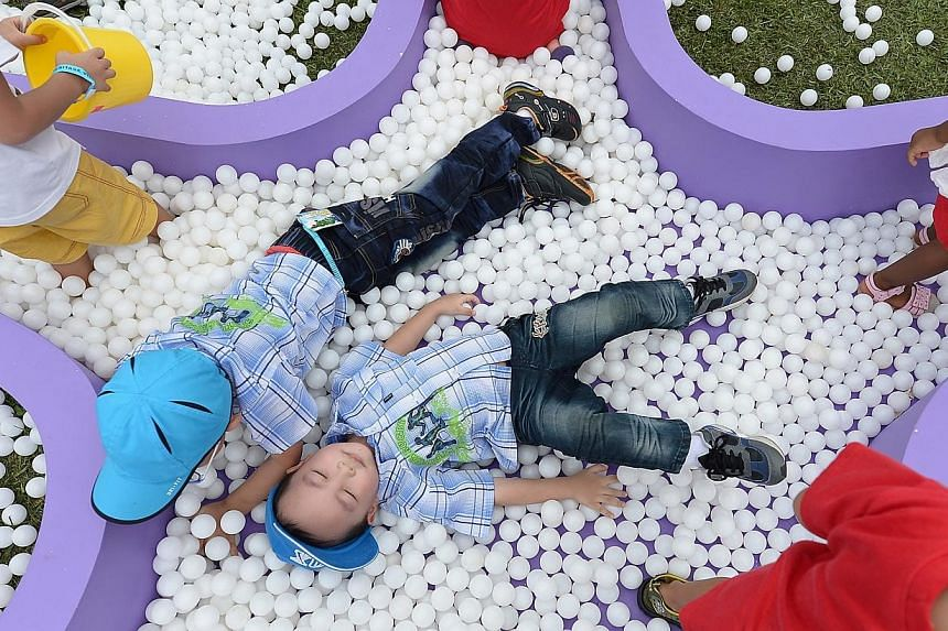 Children playing at this year's Istanaopen house event on Saturday, Aug 2, 2014. -- ST PHOTO:NG SOR LUAN
