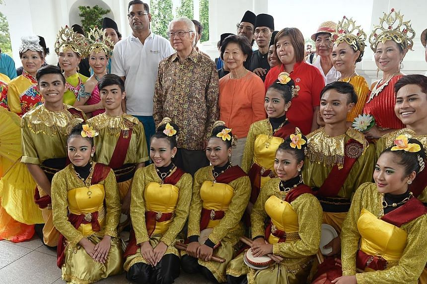 President Tony Tan and his wife with performers at the Istana open house event on Saturday, Aug 2, 2014. -- ST PHOTO:NG SOR LUAN