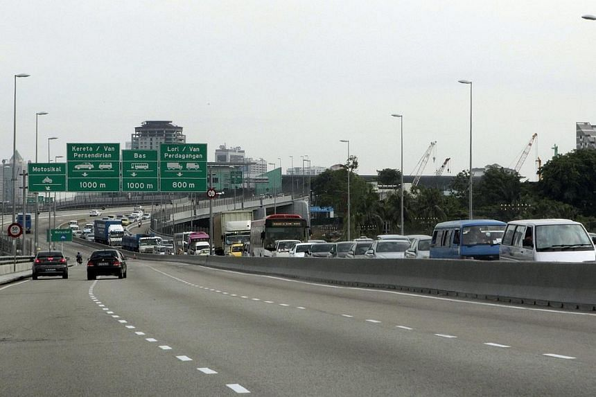 Motorists will soon have to pay higher toll rates on the Singapore side of the Causeway, after the Land Transport Authority (LTA) said yesterday that it will match Malaysia's new levies in the next few weeks. -- ST PHOTO:NEO XIAOBIN