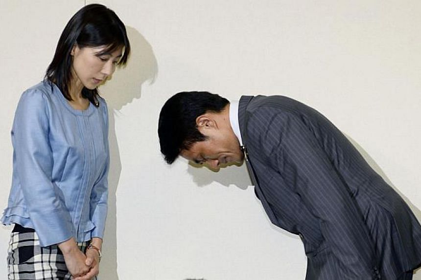 File picture of Tokyo city assembly lawmaker Akihiro Suzuki (R) bowing to apologise to female lawmaker Ayaka Shiomura last month for hurling sexist jibes at her in the Tokyo assembly when she was talking about measures to support child raising and bo