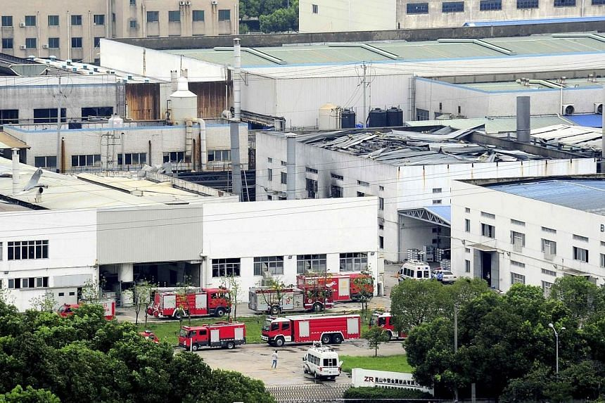 Firefighter trucks are seen next to a damaged building after an explosion at a factory in Zhoushan, Jiangsu province on Saturday, Aug 2, 2014.General Motors said on Sunday, Aug 3, that it had asked its main Chinese supplier to find an alternati