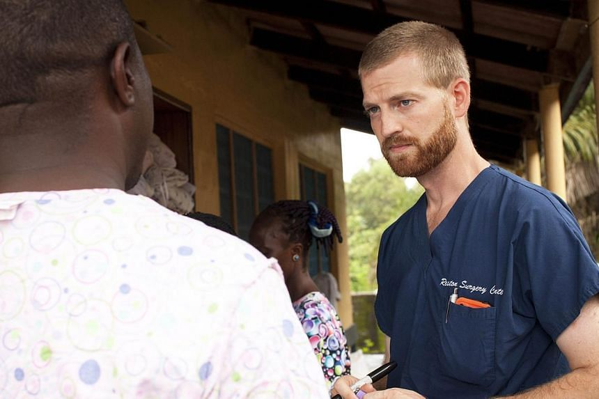 """This undated handout photo obtained July 30, 2014 courtesy of Samaritan's Purse shows Dr. Kent Brantly near Monrovia, Liberia.A United States doctor infected with the Ebola virus """"seems to be improving,"""" a top US health official said on Sunday,"""