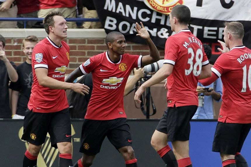 Ashley Young (#18) of Manchester United celebrates his first half goal against Real Madrid with Michael Keane (#38), Wayne Rooney (#10) and Phil Jones (#4), left, during the Guinness International Champions Cup at Michigan Stadium. -- PHOTO: AFP