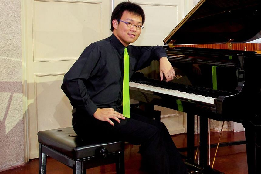 Pianist Thomas Ang showed his skill during his recital, masterfully performing pieces despite the rumbles coming from the National Day Parade preview that was being held nearby. -- PHOTO: PATRICK ANG