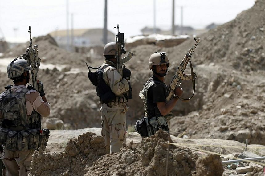 Afghan security personnel arrive at the site of an attack, near a building north of Kabul International Airport in Kabul July 17, 2014. British combat troops could return to Afghanistan if the country once again becomes a haven for terror groups