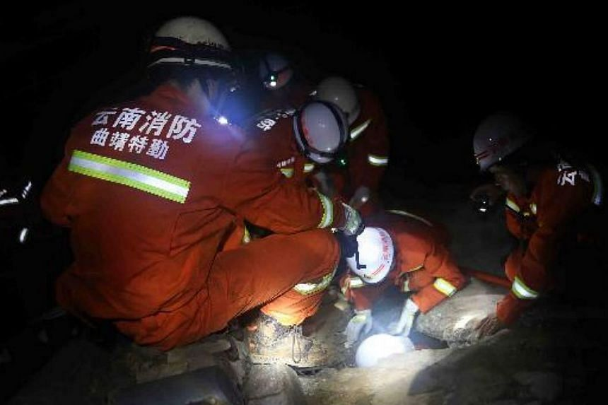 Firemen working at the disaster-stricken area. -- PHOTO: CHINA DAILY/ASIA NEWS NETWORK